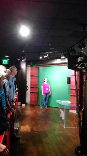 Passenger Shelly Stege demonstrating the green screen at CNN Studios in Atlanta GA. Southern Hospitality 2016